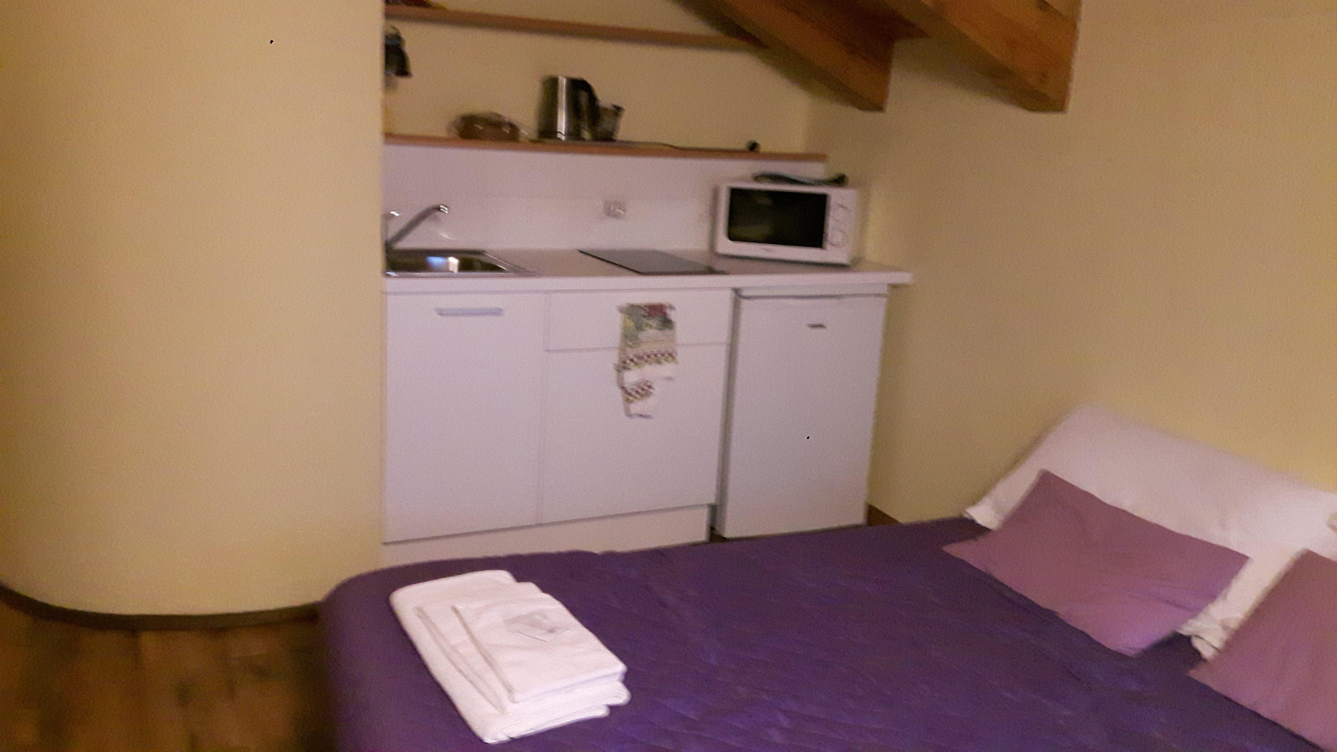 soggiorno cucina divano letto
